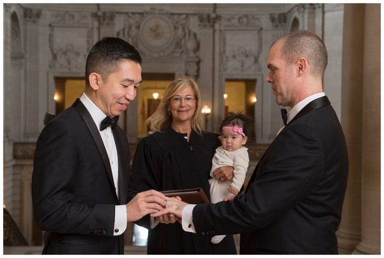 Exchanging vows at an intimate San Francisco City Hall Ceremony, Photo by City Hall Wedding Photography by Michael